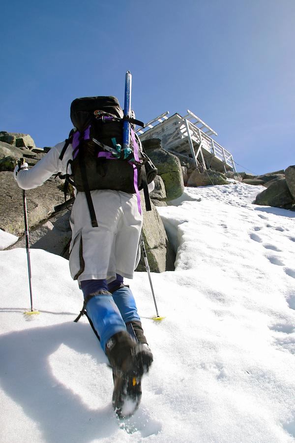 Man climbing on snow towards Mount Pilchuck Lookout, Snohomish County, Cascade Mountains, Washington, USA