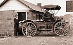 Product: International Harvester Auto Wagon<br /> <br /> Southwestern Ohio:  Farm worker loading milk containers onto the International Harvester Auto Wagon at the Brady Family farm - 1916