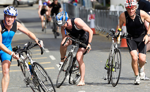 03 JUL 2010 - ATHLONE, IRL - Competitors dismount during the Citizens Race at the European Triathlon Championships .(PHOTO (C) NIGEL FARROW)