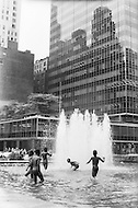 Manhattan, New York City, NY. 1973. <br /> Group of black kids playing in the water fountain of the Seagram Building on Park Ave. during the summer of 1973. This was a very rare moment.