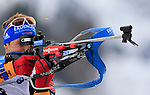 France's Martin Fourcade competes during the men relay race of the biathlon World Cup on December 13, 2014 in Hochfilzen, Austria.