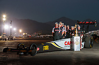 Nov 8, 2018; Pomona, CA, USA; NHRA top fuel driver Steve Torrence poses for a portrait with crew members prior to the Auto Club Finals at Auto Club Raceway. Mandatory Credit: Mark J. Rebilas-USA TODAY Sports