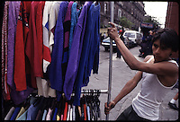 Street life in Mexico city.  Here a man transports clothes to his street stall.  Mexico City 07-95