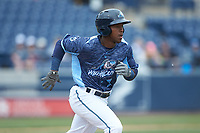 Alexis Garcia (7) of the West Michigan Whitecaps hustles down the first base line against the South Bend Cubs at Fifth Third Ballpark on June 10, 2018 in Comstock Park, Michigan. The Cubs defeated the Whitecaps 5-4.  (Brian Westerholt/Four Seam Images)