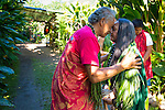 Anakala Pilip Solatorio following ancient Hawaiian protocol for accepting visitors into Halawa Valley on the island of Molokai, Hawaii, USA