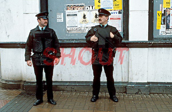 RUC officers on armed foot patrol on the streets of Northern Ireland. This image may only be used to portray the subject in a positive manner..©shoutpictures.com..john@shoutpictures.com