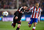 Leverkusen's Swiss forward Josip Drmic vies with Atletico Madrid's Brazilian defender Joao Miranda during the round of 16 second leg UEFA Champions League football match Atletico de Madrid vs Bayern Leverkusen at the Vicente Calderon stadium in Madrid on March 17, 2015.  PHOTOCALL3000/ DP