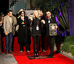 UK musician Ringo Starr steps on his star with wife Barbara Bach as he was honored with the 2,401st Star on the Hollywood Walk of Fame in Los Angeles, California 08 February 2010. The former Beatle was joined by his wife Barbara Bach, Joe Walsh, Ben Harper and Don Was. This Monday evening ceremony also marked the 50th anniversary of groundbreaking on the sidewalk attraction..Photo by Nina Prommer/Milestone Photo