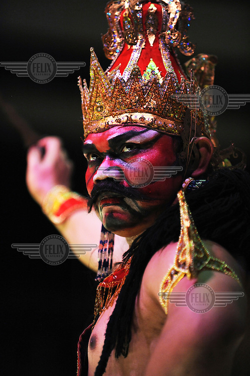 An actor performs in an Indonesian variant of the Ramayana epic being staged in the 9th Century CE Prambanan Hindu temple complex. The ancient Sanskrit tale originated in India and versions spread throughout the contemporary Hindu world.