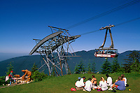 Grouse Mountain, North Vancouver, BC, British Columbia, Canada - People picnicking and watching Gondola Airtram Sky Ride, Summer Picnic