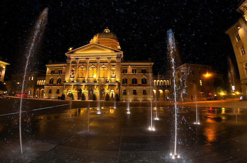 Water fountains in Bundesplatz (Confederation Plaza) with the Parliament Building (Federal Palace of Switzerland) in background at night, Bern, Canton Bern, Switzerland