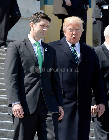 United States President Donald J. Trump, right, and US House Speaker Paul Ryan (Republican of Wisconsin), left, walk down the steps of the US Capitol after attending the Friends of Ireland Luncheon at the U.S Capitol on March 16, 2017 in Washington, DC.<br /> Credit: Olivier Douliery / Pool via CNP /MediaPunch