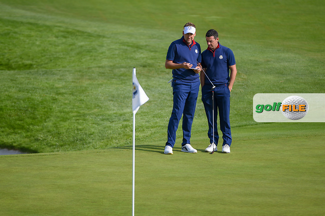 Ian Poulter (Team Europe) and Rory McIlroy (Team Europe) look over their putt on 9 during Friday's foursomes of the 2018 Ryder Cup, Le Golf National, Guyancourt, France. 9/28/2018.<br /> Picture: Golffile   Ken Murray<br /> <br /> <br /> All photo usage must carry mandatory copyright credit (© Golffile   Ken Murray)