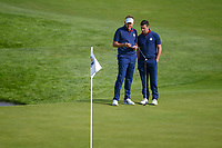 Ian Poulter (Team Europe) and Rory McIlroy (Team Europe) look over their putt on 9 during Friday's foursomes of the 2018 Ryder Cup, Le Golf National, Guyancourt, France. 9/28/2018.<br /> Picture: Golffile | Ken Murray<br /> <br /> <br /> All photo usage must carry mandatory copyright credit (&copy; Golffile | Ken Murray)