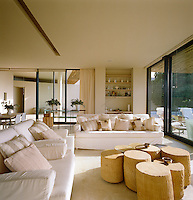 A group of movable stone tables form the focal point of this comfortable contemporary living room