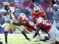 QB Ricky Dobbs of Navy is tackled by Terrapins' Bradley Johnson. Maryland defeated Navy 17-14 at the M&T Bank in Baltimore, MD on Monday, September 6, 2010. Alan P. Santos/DC Sports Box