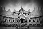 A vignetted, black and white image of Pagarayung Palace, in Batusangkar, West Sumatra, gives a historical feel to a stunning example of traditional Minangkabau architecture.