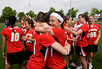 Kate Faas (26) and Brittany Poist (27) of Maryland embrace after the ACC women's lacrosse tournament finals in College Park, MD.  Maryland defeated North Carolina, 10-5.