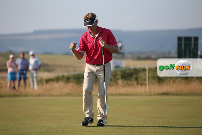 Bernhard Langer (GER) sinks back-to-back birdies on 17 and 18 to take a two shot lead with a 65 during Round One of the 2014 Senior Open Championship presented by Rolex from Royal Porthcawl Golf Club, Porthcawl, Wales. Picture:  David Lloyd / www.golffile.ie