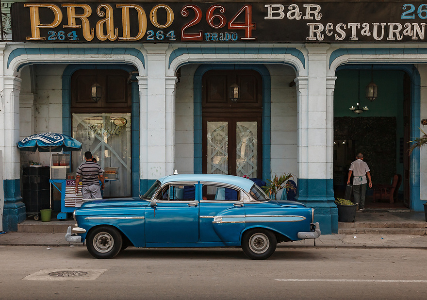 Blue 1950s Chevy in front of Prado 264 restaurant, Havana.