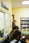 Alix Shattuck, Director of the Pregnancy Aid Clinic in Hapeville, Georgia, listens in on a class about single motherhood at the clinic, which offers women free support, including ultrasounds, pregnancy tests, classes, and supplies. Seen November 7, 2013.
