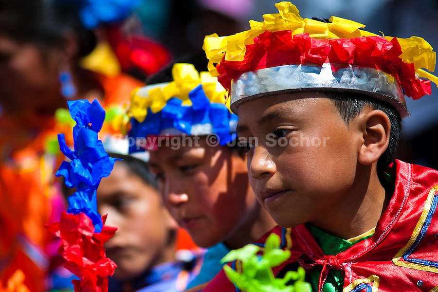 Boy dancers (danzantes) perform in the religious parade within the Corpus Christi festival in Pujilí, Ecuador, 1 June 2013. Every year in June, thousands of people gather in a small town of Pujili, high in the Andes, to celebrate the Catholic feast of Corpus Christi. Introduced originally during the Spanish conquest of South America, this celebration merges Catholic rituals of Holy Communion with the traditional Andean harvest and sun festivities (Inti, the Inca sun god). Women dancers perform wearing brightly colored costumes while men dancers wear chest ornaments and heavy elaborate headdresses adorned with mirrors, jewelry, or natural items (shells). Being a dancer in the Corpus Christi ceremonial parade (El Danzante) is considered an honour and a privilege by the indigenous people in Ecuador.