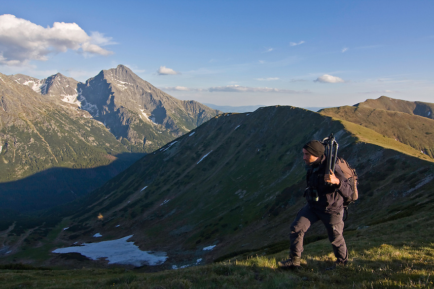 The photographer Bruno D'Amicis walking on a ridge in the Western Tatras with Mount Krivàn (2495 m asl), national symbol of Slovakia, in the background. Western Tatras, Slovakia. June 2009. Mission: Ticha