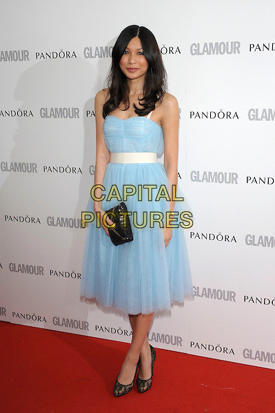 Gemma Chan.Women Of The Year 2012 - Glamour Awards, Berkeley Square, London, England..29th May 2012.full length blue tulle dress black clutch bag white belt .CAP/PL.©Phil Loftus/Capital Pictures.