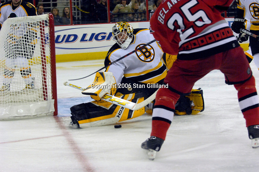 The Boston Bruins' goalie Tim Thomas gets his pad on a shot from the Carolina Hurricanes' Eric Belanger (25) during an NHL hockey game Saturday, Dec. 2, 2006 in Raleigh, N.C. Carolina won 5-2.<br />