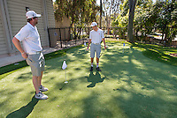 Golf Coach Andrew Larkin and Cam Conner '17 use the new putting green on the Occidental College campus on March 26, 2015. The outdoor facility may be called: Andrew E. Rubin Practice Facility, including the Pongracz and Wright Families Putting Green & Tiger Golf Hitting Bays.<br />