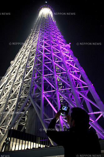 """May 24, 2012, Asakusa, Japan - A visitor takes a picture of the Tokyo Skytree by Nintendo SD?s camera...Tokyo Skytree has two lighting styles, the concept of the design is based on Japanese  aesthetic """"Miyabi"""" in purple and blue """"Iki"""" represents the essence of Kokoroiki. The tower opened to the public on May 22nd 2012 and at 634m is the worlds' 2nd tallest building and the worlds' tallest tower."""