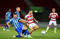 Doncaster Rovers' Jon Taylor is tackled by Blackpool's Ryan Edwards and Jordan Thompson<br /> <br /> Photographer Alex Dodd/CameraSport<br /> <br /> The EFL Sky Bet League One - Doncaster Rovers v Blackpool - Tuesday September 17th 2019 - Keepmoat Stadium - Doncaster<br /> <br /> World Copyright © 2019 CameraSport. All rights reserved. 43 Linden Ave. Countesthorpe. Leicester. England. LE8 5PG - Tel: +44 (0) 116 277 4147 - admin@camerasport.com - www.camerasport.com