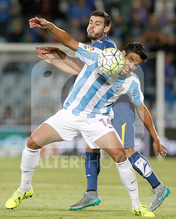 Getafe's Victor Rodriguez (b) and Malaga's Jose Luis Garcia Recio during La Liga match.September 18,2015. (ALTERPHOTOS/Acero)