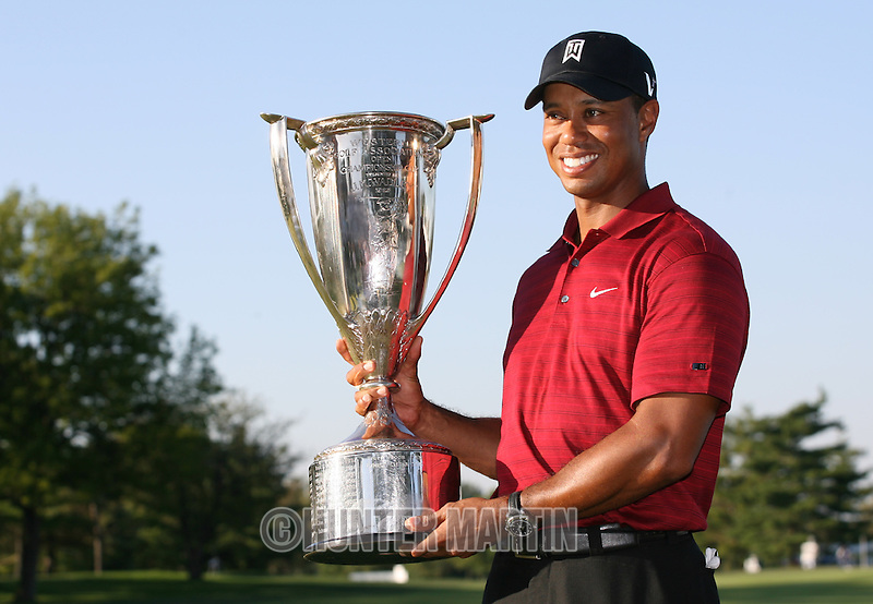 LEMONT, IL - SEPTEMBER 13: Tiger Woods holds the J.K. Wadley trophy after winning the BMW Championship at Cog Hill Golf & Country Club on September 13, 2009 in Lemont, Illinois. (Photo by Hunter Martin/Getty Images) *** Local Caption *** Tiger Woods