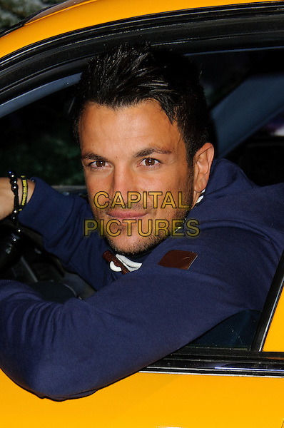 Peter Andre.Peter Andre launches Christmas in New York at Glow, Bluewater Shoppiing Center, Kent, England..December 8th, 2011.headshot portrait stubble facial hair car yellow blue jacket  .CAP/CJ.©Chris Joseph/Capital Pictures.