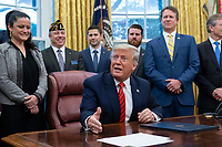 United States President Donald J. Trump participates in a signing ceremony for S. 153, The Supporting Veterans in STEM Careers Act at the White House in Washington, DC, February 11, 2020. Credit: Chris Kleponis / Pool via CNP/AdMedia