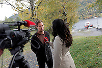 On Oct 3rd 2011 media was allowed to visit the Utoya island for the first time since the July 22 terror attacks. AUF leader Eskil Pedersen talks to media...The 2011 Norway attacks were two sequential terrorist attacks against the government, the civilian population and a summer camp in Norway on 22 July 2011. The first was a car bomb explosion in Oslo within Regjeringskvartalet, the executive government quarter of Norway. The second attack occurred less than two hours later at a summer camp on the island of Utoya in Tyrifjorden, Buskerud. The camp was organized by AUF, the youth division of the ruling Norwegian Labour Party (AP). A gunman dressed in an authentic looking police uniform gained access to the island and subsequently opened fire at the participants, killing 69 attendees, including personal friends of Prime Minister Jens Stoltenberg and the stepbrother of Norway's crown princess Mette-Marit..The Norwegian Police Service arrested Anders Behring Breivik, a 32-year-old Norwegian right-wing extremist and terrorist responsible for the mass shootings on Utoya. .(Foto:Fredrik Naumann/Felix Features)