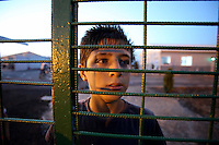 Photographer: Rick Findler..07.10.12 Jack 13 from Idlib looks through the fencing of a refugee camp on the border of Turkey and Syria. Jack had fled the violence in Idlib with his family four months ago and has been in this camp in the town of Killis since then.