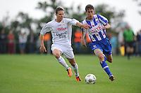 VOETBAL: OUDEGA (W): Sportpark It Joo, 17-07-2012, Oefenwedstrijd SC Heerenveen-Waasland Beveren (BEL), Cédric D'Ulivo (#19), Filip Djuricic (#9), ©foto Martin de Jong