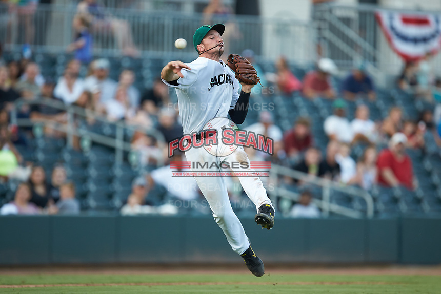 Augusta GreenJackets third baseman Jacob Gonzalez (18) makes a throw to first base against the Kannapolis Intimidators at SRG Park on July 6, 2019 in North Augusta, South Carolina. The Intimidators defeated the GreenJackets 9-5. (Brian Westerholt/Four Seam Images)