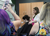 """NWA Democrat-Gazette/CHARLIE KAIJO Kasey Coonrod of Bentonville (center right) works on the hair of Anna Sarratt during a formal hair class, Monday, May 13, 2019 at Sola Salons in Bentonville.<br /><br />""""A lot of stylists are new to this industry or want more confidence in this area and the best way is through education,"""" Kasey Coonrod said of her reason to have the class. """"Some stylists are intimidated by weddings and formal events."""""""