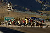 Apr 8, 2006; Las Vegas, NV, USA; Safety crew members work to remove the car of NHRA Top Alcohol Funny Car driver Cy Chesterman after his parachutes failed to deployed and he crashed into the catch net at the SummitRacing.com Nationals at Las Vegas Motor Speedway in Las Vegas, NV. Chesterman was unhurt in the incident. Mandatory Credit: Mark J. Rebilas