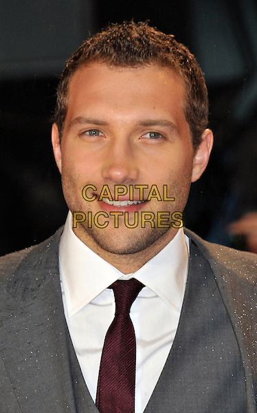 Jai Courtney .arriving at the premiere for 'A Good Day To Die Hard' at the Empire cinema, Leicester Square, London, UK, .7th February 2013..portrait headshot red burgundy tie suit white shirt grey gray smiling beard facial hair stubble .CAP/WIZ.© Wizard/Capital Pictures.