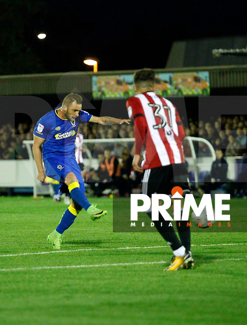 AFC Wimbledon's Dean Parrett shoots on goal during the Carabao Cup match between AFC Wimbledon and Brentford at the Cherry Red Records Stadium, Kingston, England on 8 August 2017. Photo by Carlton Myrie.