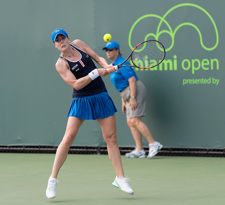Key Biscayne, FL - March 26: Alize Cornet (FRA) in action here defeats Elena Vesnina (RUS) 64 61 to move into the 3rd round of the 2015 Miami Open in Key Biscayne, Florida. Photographer Andrew Patron - CameraSport/BigShots<br /> <br /> Tennis - 2015 Miami Open presented by Itau - Crandon Park Tennis Center - Key Biscayne, Florida - USA - Day 4, Thursday 26th March 2015<br /> <br /> &copy; CameraSport - 43 Linden Ave. Countesthorpe. Leicester. England. LE8 5PG - Tel: +44 (0) 116 277 4147 - admin@camerasport.com - www.camerasport.com