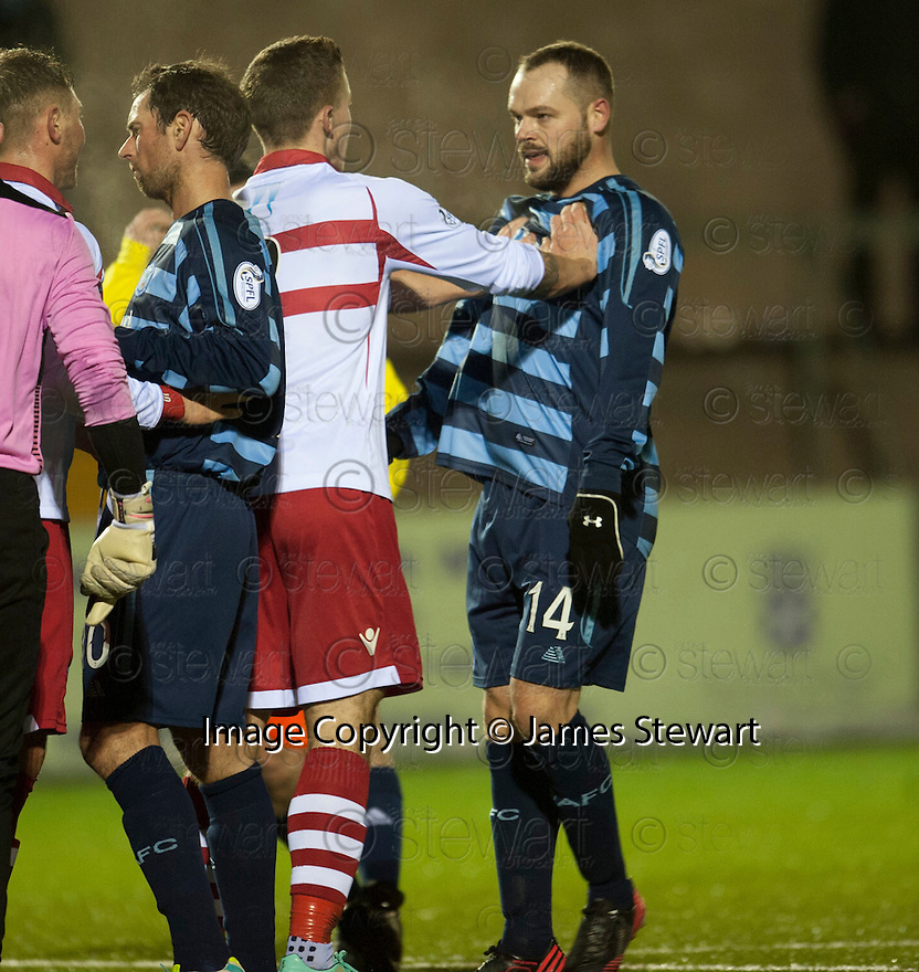 Stirling's Lee Hamilton and Forfar's Martyn Fotheringham face up to each other after Stirling keeper Callum Reidford reacts to Forfar's Dale Hilson challenge.