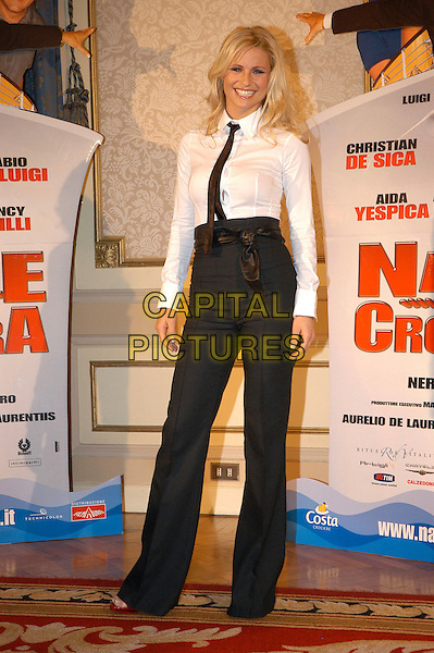MICHELLE HUNZIKER .Photocall for the film di Neri Parenti 'Natale in crociera'.December 13th, 2007.full length black white shirt trousers high waist waisted tie.CAP/CAV.©Luca Cavallari/Capital Pictures.