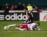 Marcelo Saragosa (11) of D.C. United is fouled by Teemu Tainio (6) of New York Red Bulls during the game at RFK Stadium in Washington DC. D.C. United tied New York Red Bulls, 1-1.
