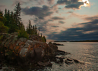 Storm clouds move onshore from Lake Superior over the Islae Royale National Park shoreline, Keweenaw County, Michigan