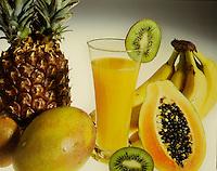 Still life con frutta tropicale, ananas, banane, kiwi, papaia, mango, con un bicchiere di succo su sfondo bianco.<br /> Still life with tropical fruit, pineapple, banana, kiwi, papaya, mango, with a glass of juice on white background.